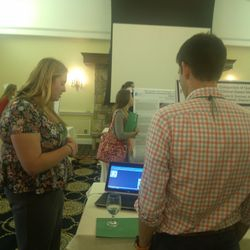 Samantha explaining the MatScan system to an NH-INBRE Conference attendee
