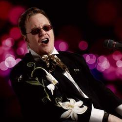 Marcus Wells as Sir Elton