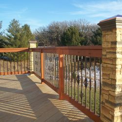 Cedar decking and Cedar, Metal and Stone railing