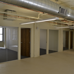 New glass front offices make the space bright.