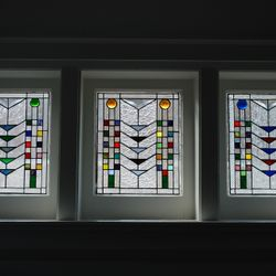A trio of Frank Lloyd Wright inspired windows for a Master bedroom.