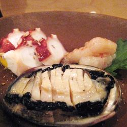An assortment of Baby Abalone, Octopus, and orange clam