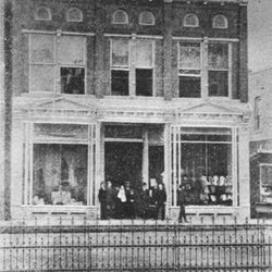 Charles & Ben Rheinauer standing in front of their store, Rheinauer & Brothers in the Square.