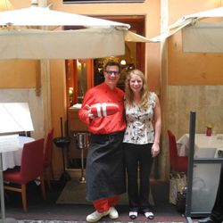 Chef Massimo and Caitlin pose with a Shucks Maine Lobster buoy - at Rome's oldest seafood restaurant.