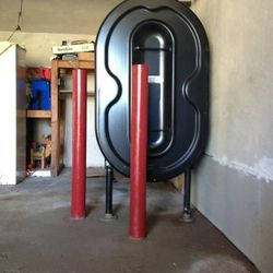New Oil tank installed in garage with lally columns