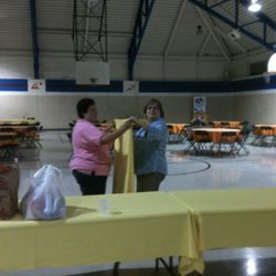 Mary and Leslie helping at CCH on 10/12/13 setup the silent auction.