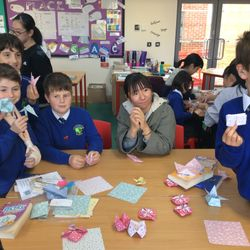 Japanese student sharing origami