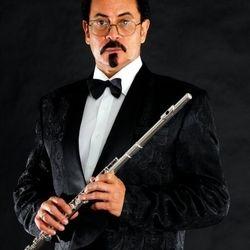 Tee Mac Iseli- Flautist,  philharmonic composer and philanthropist.