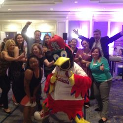 Volunteers celebrating with Fredbird at the March of Dimes Chefs Auction