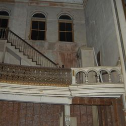 Original second level balcony.