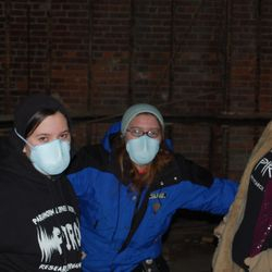 Renee Heroux, Kirstie Nicholson, and Kassi McSherry donning respirator masks for safety.
