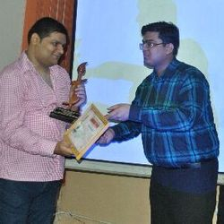 Receiving moments of memento for 'The Unknown world' at Gurumantra 2012.