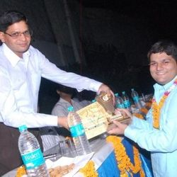 Receiving honors from District Magistrate of Aligarh for 'The Unknown World' in 2012 at Manav Upkar Event.