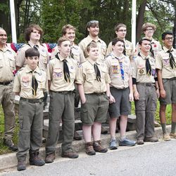 Boy Scout Troop 755 poses in front of the Odenton Veterans Memorial at the annual wreath laying ceremony on Memorial Day.