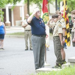 Joshua McKerrow, staff / Capital Gazette VFW District 6 Sr Vice Commander Christine Sandoval, past Commander of Post 160 Gil Campion, and Boy Scouts of Troop 755 salute the Odenton Veterans Memorial on Memorial Day.