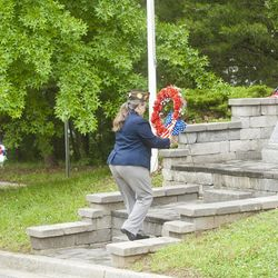 Joshua McKerrow, staff / Capital Gazette VFW District 6 Sr Vice Commander Christine Sandoval, with past Commander of Post 160 Gil Campion, places a wreath at the Denton Veterans Memorial at the annual Troop 755-hosted wreath laying ceremony on Memorial Day.