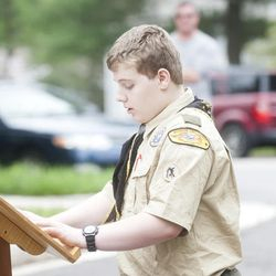 Joshua McKerrow, staff / Capital Gazette Boy Scout Nicholas Lightner hosts the annual Troop 755-hosted wreath laying ceremony at the Odenton Veterans Memorial on Memorial Day.