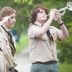 "Boy Scout Johnathan Hiett plays ""Taps"" at the annual Troop 755-hosted wreath laying ceremony at the Odenton Veterans Memorial on Memorial Day."
