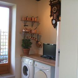 French doors inserted into original bathroom space to open up onto garden for BBQ's in the summer