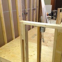 New reception desk framing.