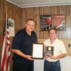 Former Youth Director, Shane Brady, is recognized by the Westville Town Supervisor for 20 years of service.