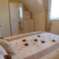 We have two double bedrooms and a camp bed.