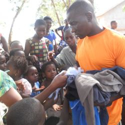 Donating used clothing to children and parents at Eleme