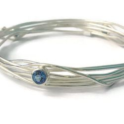 Hand made silver wrap bangle with blue topaz - Unique hand made jewellery