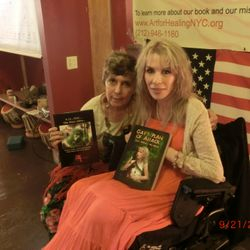 "Loren Ellis with ""9.11...The Days After..."" and Gay Ffrench with her book, ""Gay's Plan of Attack."""