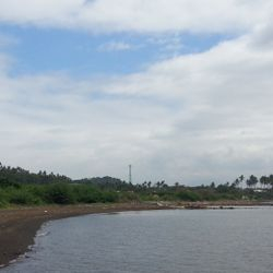 view of shoreline of Balayan Bay along Lemery side. Shoreline has brown sand ideal for parking of boats or barges.  Located in Lemery - Calaca, Batangas