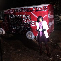 Beairshelle preps for a live report ahead of a day filled with student walkouts in honor of the Florida school shooting victims and survivors.
