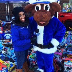 "In hour 8 of ""Stock the Sled"", Beairshelle teams up with Durham's Wool E. Bull to collect holiday toys! Nearly 2,000 gifts were donated."