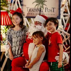 Caucasian Santa Claus with kids