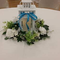 White square lantern with flicker pillar candle and greenery floral wreath