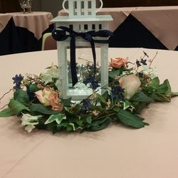 White square lantern with fairy lights and greenery floral wreath
