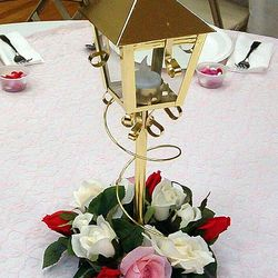 Brass tea light lamppost with floral wreath