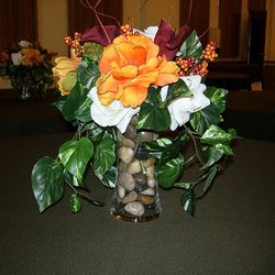 Hour glass vase with floral and natural rock