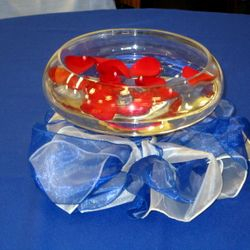 Flat fishbowl pedestal with floating petals and sashes