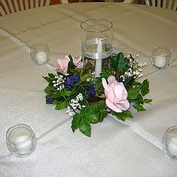 Cylinder vase with floral wreath, taper candle and votive vases/candles