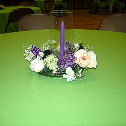 Cylinder vase with floral wreath and taper candle