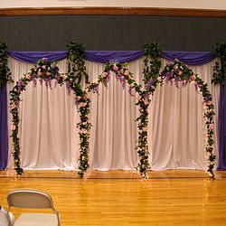 Cinderella Arches backdrop with added fabric backdrop
