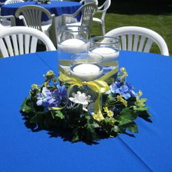 Cylinder vases with floating candles and floral wreath