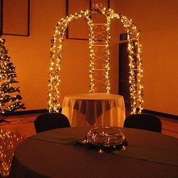 """7' 6"""" tall green pine trees with Cinderella Gazebo - room lights dimmed"""