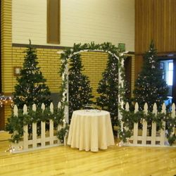 "7' 6"" tall green pine trees used with 4' wide Garden Arbor and 4' wide picket fence - cake table display"