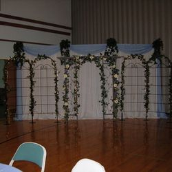 Promise Arch with added trellis panels and fabric panel backdrop