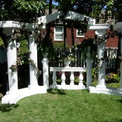 Roman Columns with grapevine garland - outdoor setup