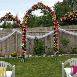 White Wedding Arches - outdoor setup