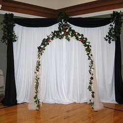 White Wedding Arch with added fabric backdrop