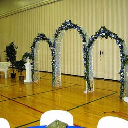 White Wedding Arches main backdrop with added pedestals and greenery urns