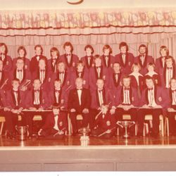 Scottish Championships 1979: Pictured after the 1979 SAFBA Scottish Championship Contest. Back row L-R: A. Stark, I. Wallace, S. Murdoch, J. Robertson, D. Russell, K. Jackson, A. Callan, D. Frame, G. Barr, T. Bryce. Middle row L-R: J. Bryson, T. Chalmers, R. Chalmers Snr, R. Chalmers Jnr, W. Gisbey Snr, N. Telfer, D. Stark, D. Lang, J. Crosbie, E. Chalmers, J. Weir, D. Bryson. Front row L-R: R. Cossar, B. Chalmers, D. Simpson, J. Smith, H. Crosbie (conductor), B. Horton, S. Young, J. Murphy, R. Barnes. On floor: W. Gisbey Jnr, B. Smith. Thanks to Duncan Brown for photo and naming everyone.